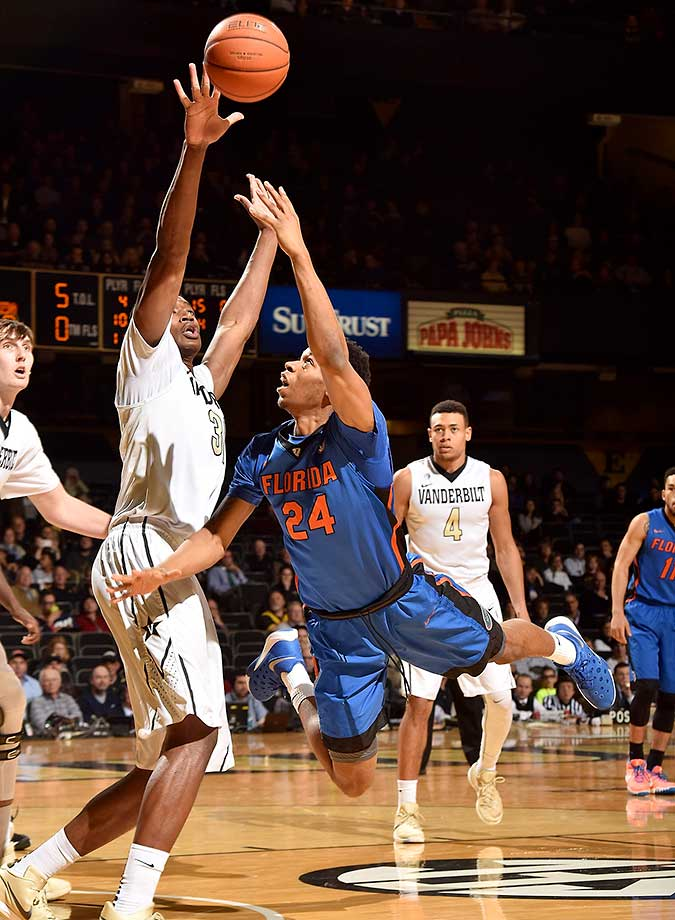 Justin Leon of the Florida Gators takes a diving shot against Damian Jones of the Vanderbilt Commodoresat Memorial Gym in Nashville.