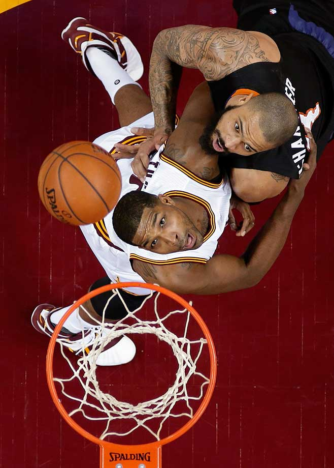Cleveland's Tristan Thompson, bottom, and Tyson Chandler of Phoenix watch the ball during the Cavaliers 115-93 victory.