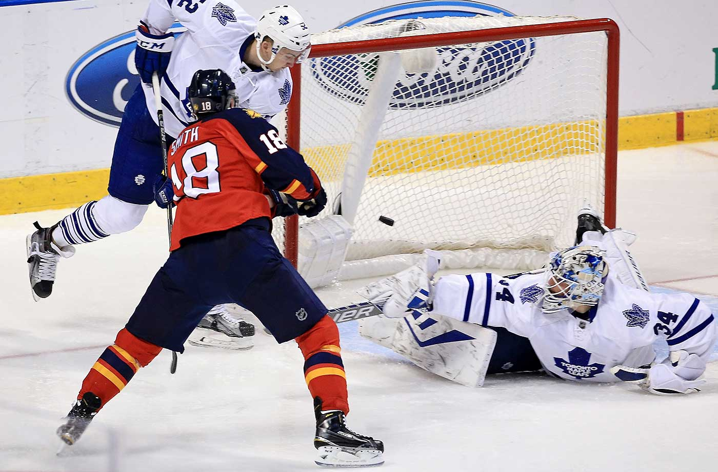 Reilly Smith of the Florida Panthers scores a goal on James Reimer of the Toronto Maple Leafs during a game at BB&T Center in Sunrise, Fla.