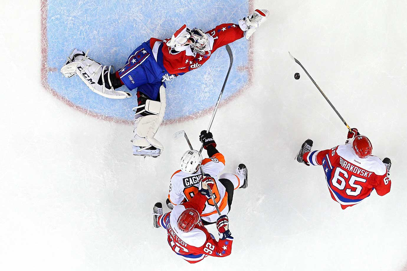 Goalie Braden Holtby of the Washington Capitals makes a save on Sam Gagner of the Philadelphia Flyers at Verizon Center in Washington, D.C. The Flyers won, 4-3, in overtime.