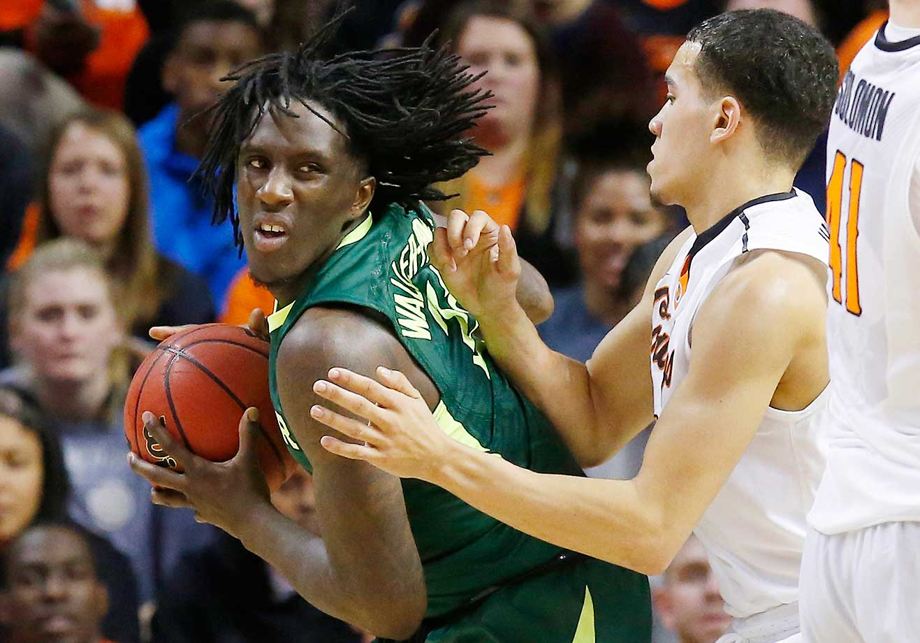 Baylor forward Taurean Prince drives against Oklahoma State guard Jeffrey Carroll in Stillwater, Okla.