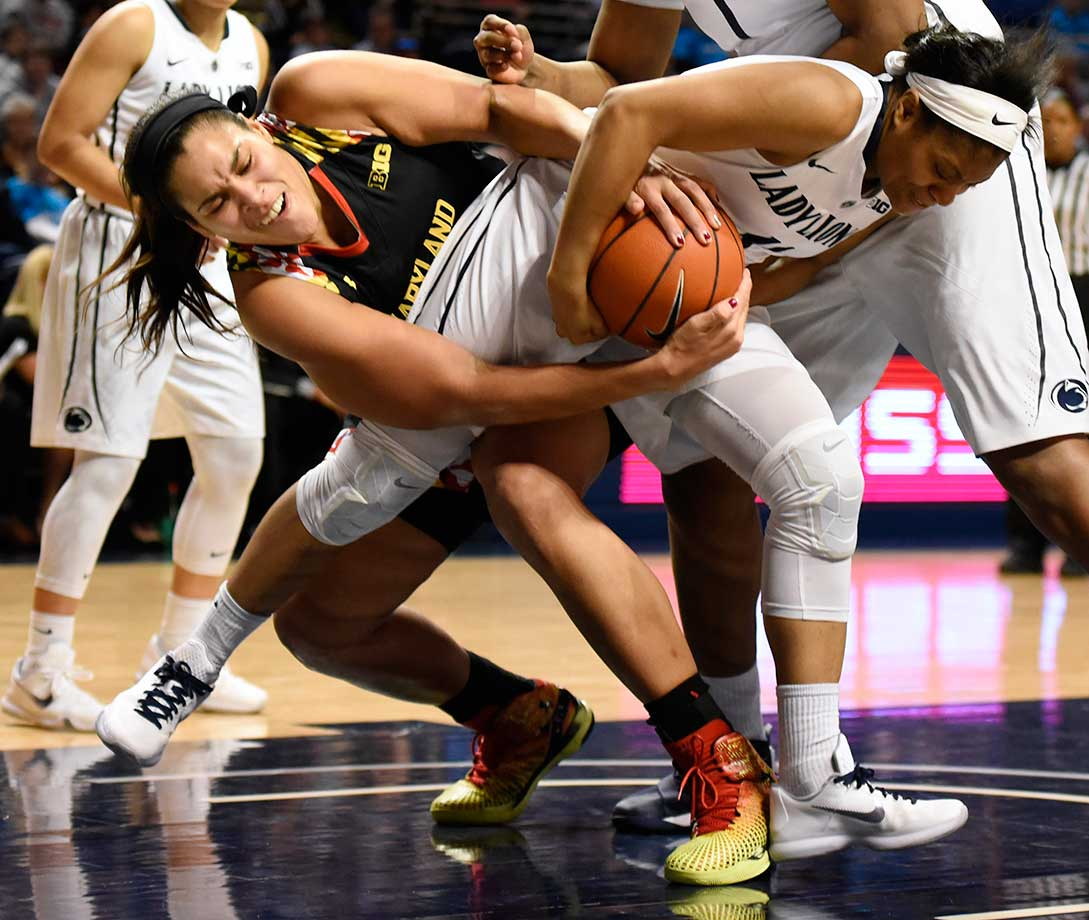 Maryland center Brionna Jones (left) and  Penn State guard Teniya Page battle for the ball in State College, Pa. Maryland defeated Penn State 89-53.