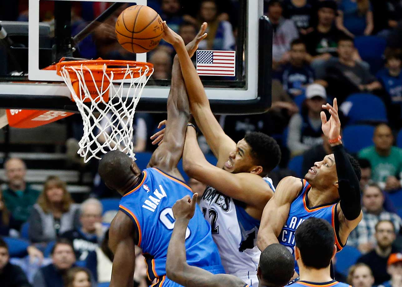 Minnesota Timberwolves' Karl-Anthony Towns manages to score as Oklahoma City Thunder's Serge Ibaka and Russell Westbrook defend in Minneapolis. The Thunder won 126-123.