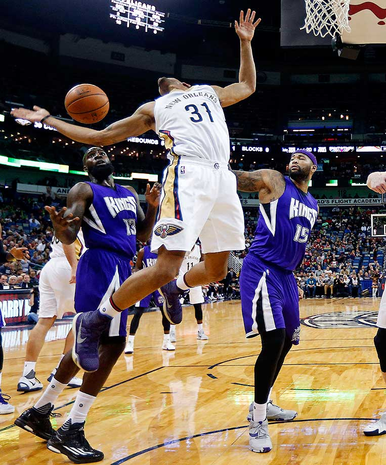 New Orleans Pelicans guard Bryce Dejean-Jones loses the ball as Sacramento Kings forward Quincy Acy (13) and center DeMarcus Cousins defend in New Orleans.