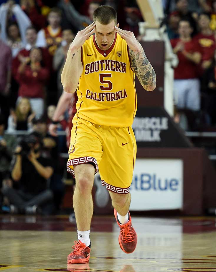 Katin Reinhardt celebrates after shooting a three-pointer during a game against the Washington State Cougarsat Galen Center in Los Angeles.