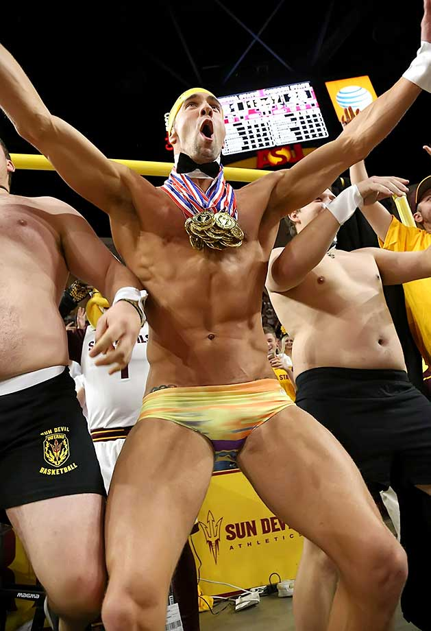 "Olympic swimmer Michael Phelps performs behind the ""Curtain of Distraction"" during an Oregon State free throw against Arizona State in Tempe, Ariz."