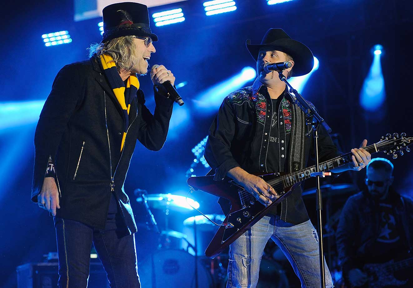 Big Kenny Alphin and John Rich of the band Big and Rich perform at the Bridgestone Winter Park Honda Stage in Nashville as part of the NHL All-Star Week festivities.