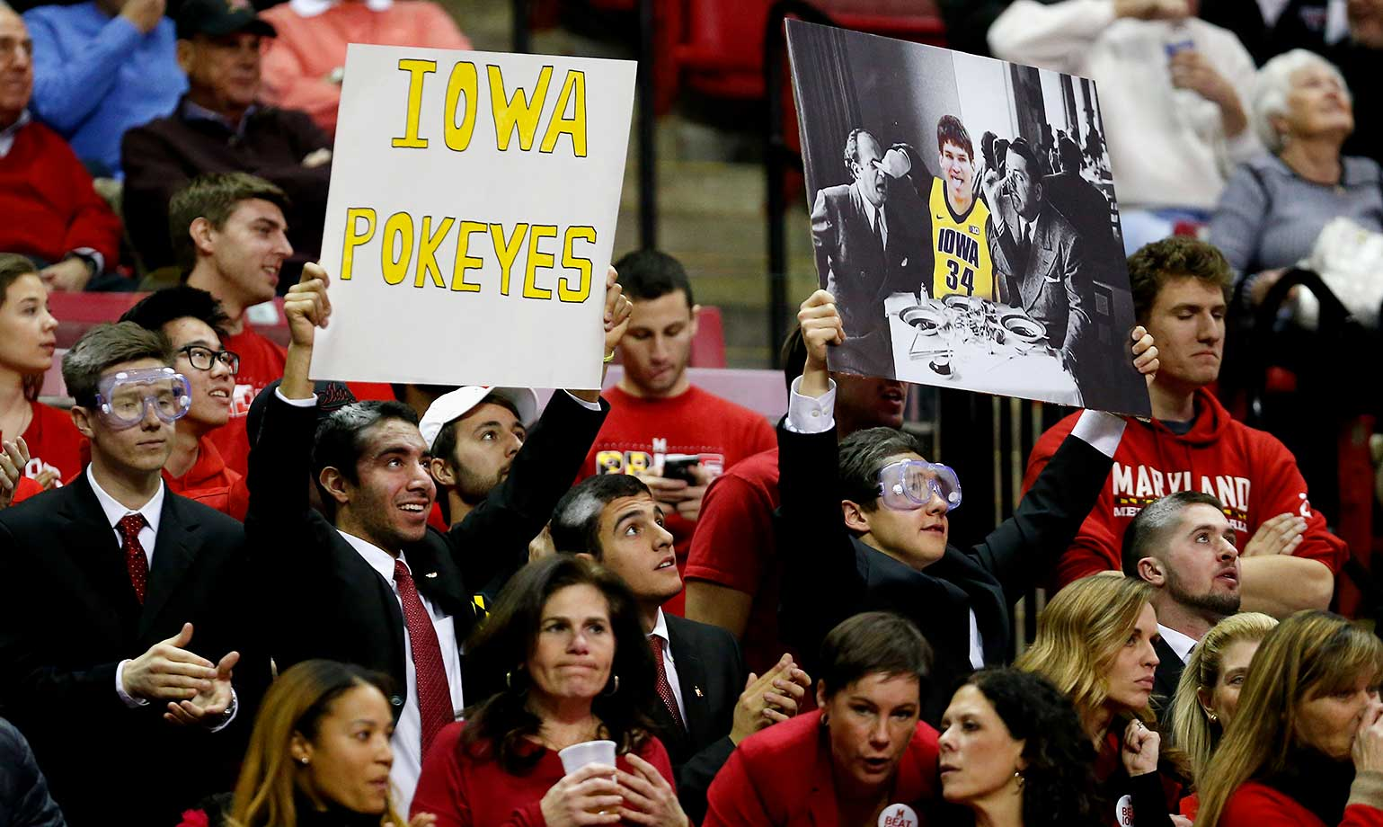 Fans hold up a sign during a game between the Maryland Terrapins and Iowa Hawkeyes at Xfinity Center  in College Park, Md.
