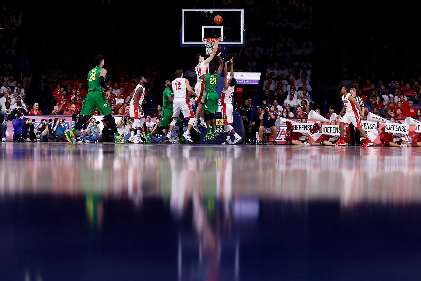 Elgin Cook of the Oregon Ducks attempts a shot over Dusan Ristic of the Arizona Wildcats at McKale Center in Tucson, Ariz.