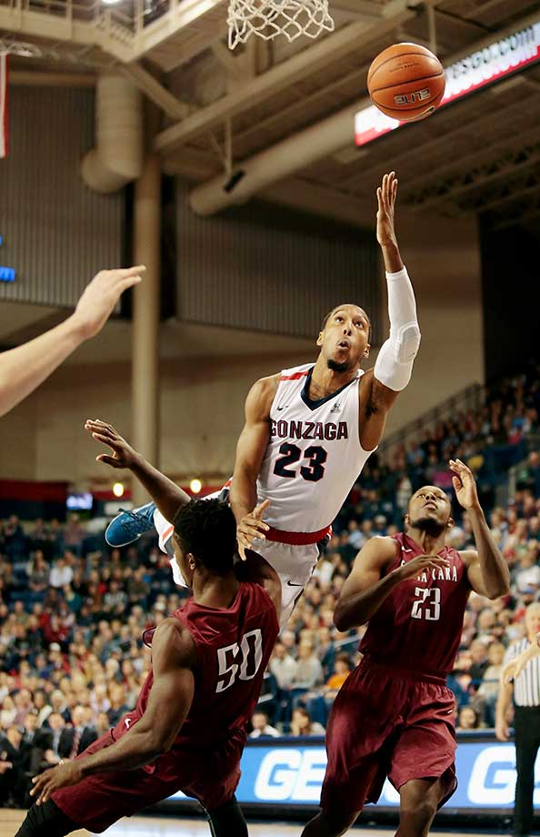 Eric McClellan of the Gonzaga Bulldogs goes to the basket and draws a foul from Emmanuel Ndumanya of the Santa Clara Broncos at McCarthey Athletic Center in Spokane, Wash.
