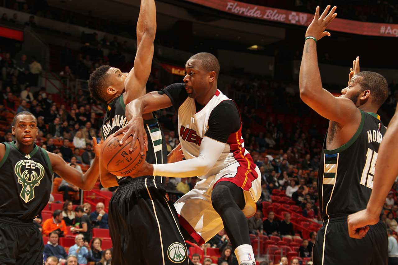 Dwyane Wade of the Miami Heat passes the ball against the Milwaukee Bucks at AmericanAirlines Arena in Miami.