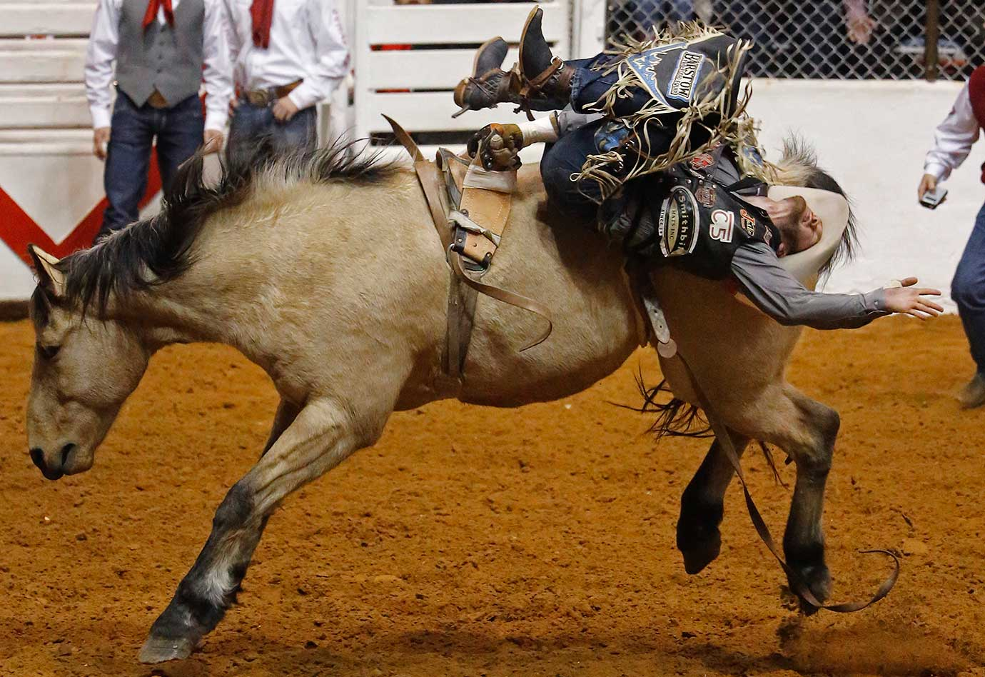 Luke Creasy hangs on to Assault for a score of 84.50 in bareback during the Super Shootout at the Fort Worth Stock Show Rodeo in Texas.