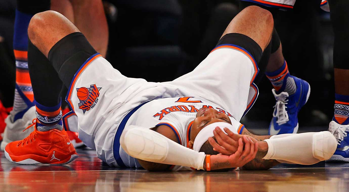 New York's Carmelo Anthony on the court after getting being blocked by the rim on an attempted dunk.