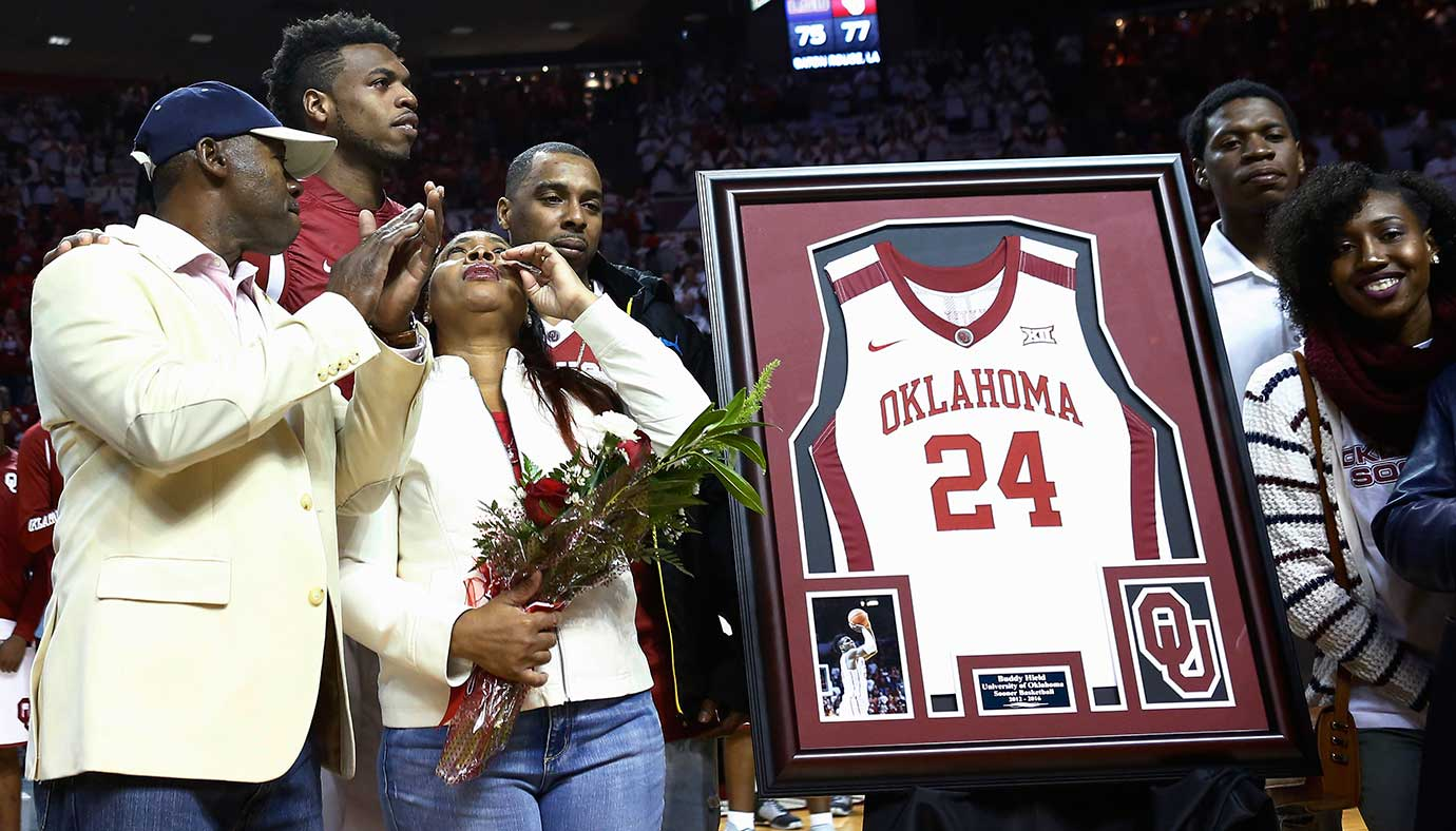 Oklahoma guard Buddy Hield, back left, stands with his family on senior night.