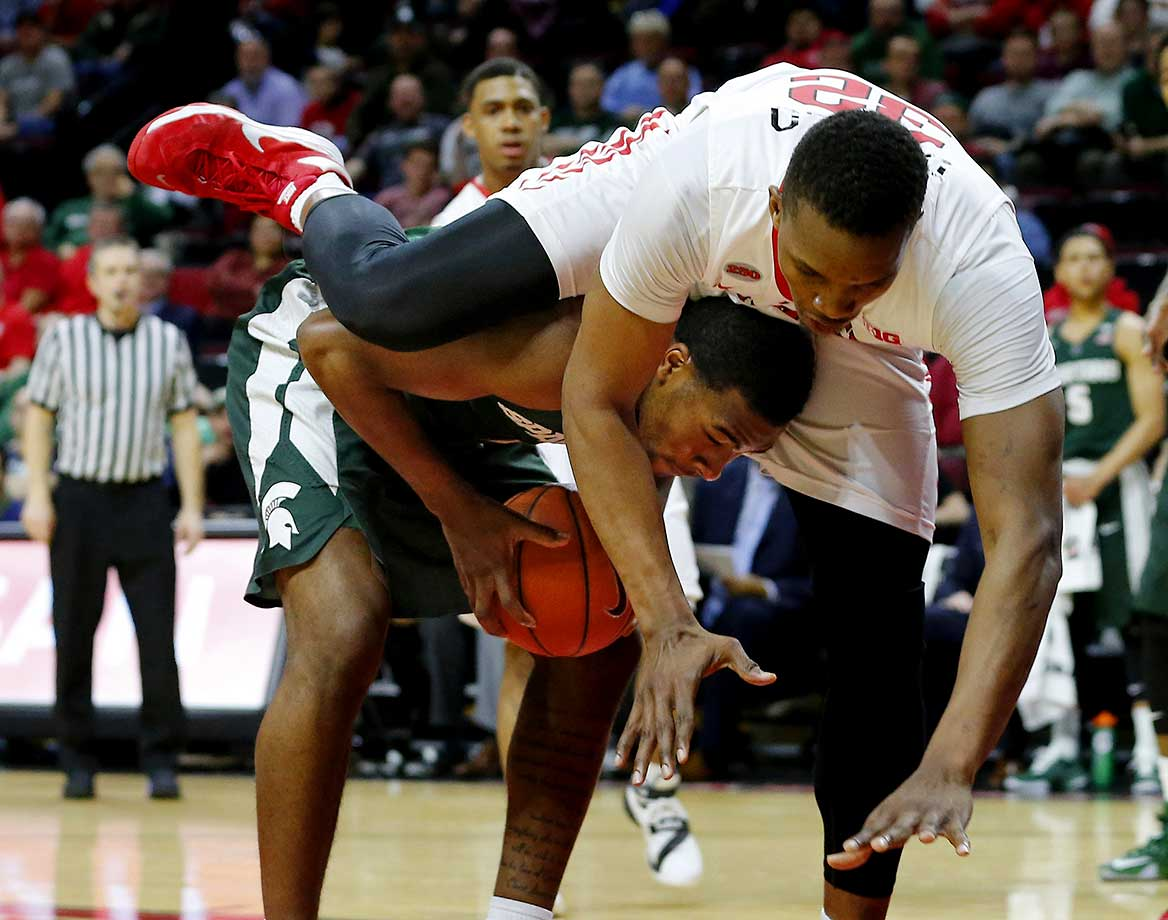 Javon Bess of the Michigan State Spartans is fouled by Ibrahima Diallo of the Rutgers Scarlet Knights.