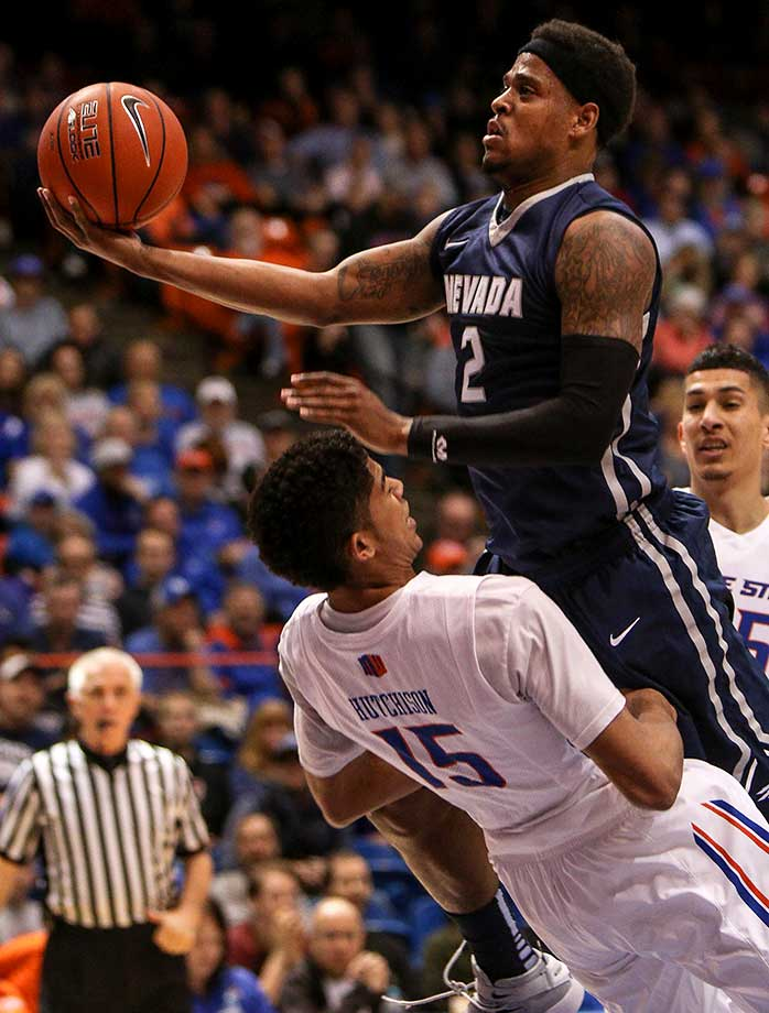 Guard Chandler Hutchison of Boise State takes a charge from guard Tyron Criswell of Nevada.