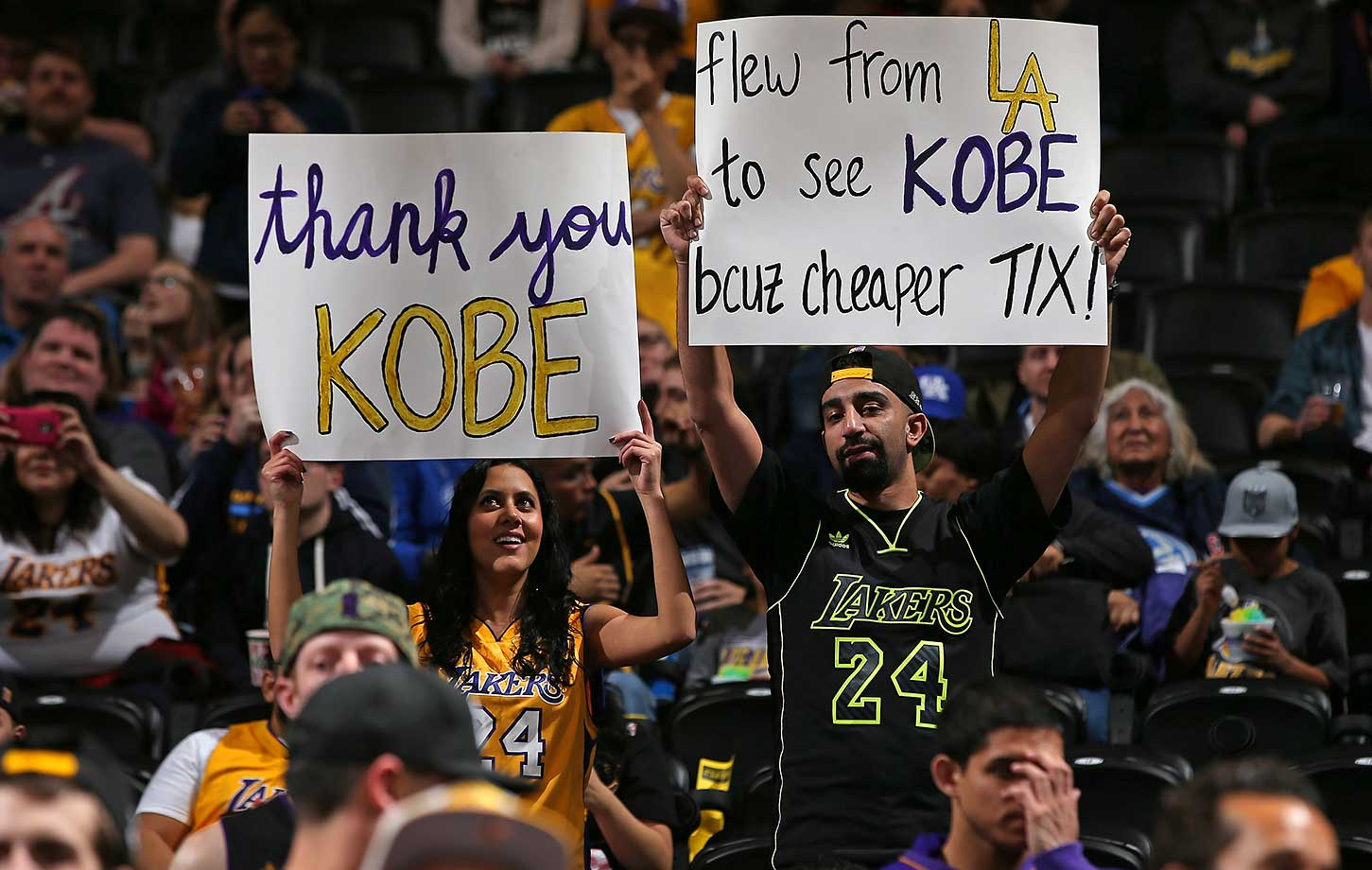 A pair of fans show their support and admiration of Kobe Bryant, who played his final game in Denver Wednesday.
