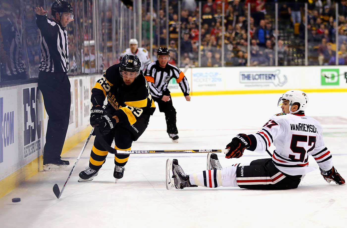 Trevor van Riemsdyk of Chicago is called for tripping against Brad Marchand of Boston.