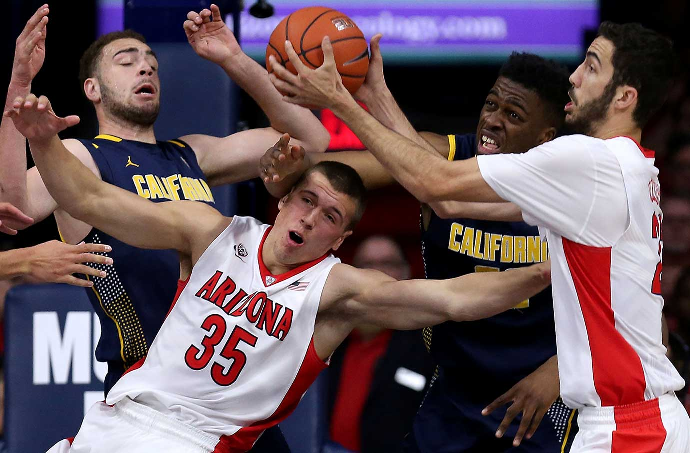 Kaleb Tarczewski (35) and Mark Tollefsen of Arizona fight for a rebound with Cal's Kameron Rooks (44) and Kingsley Okoroh.