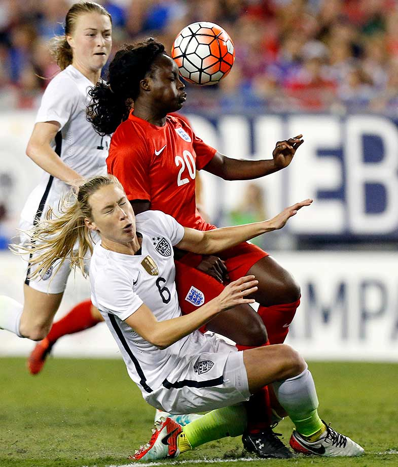Defender Whitney Engen of the U.S. collides with forward Eniola Aluko of England.