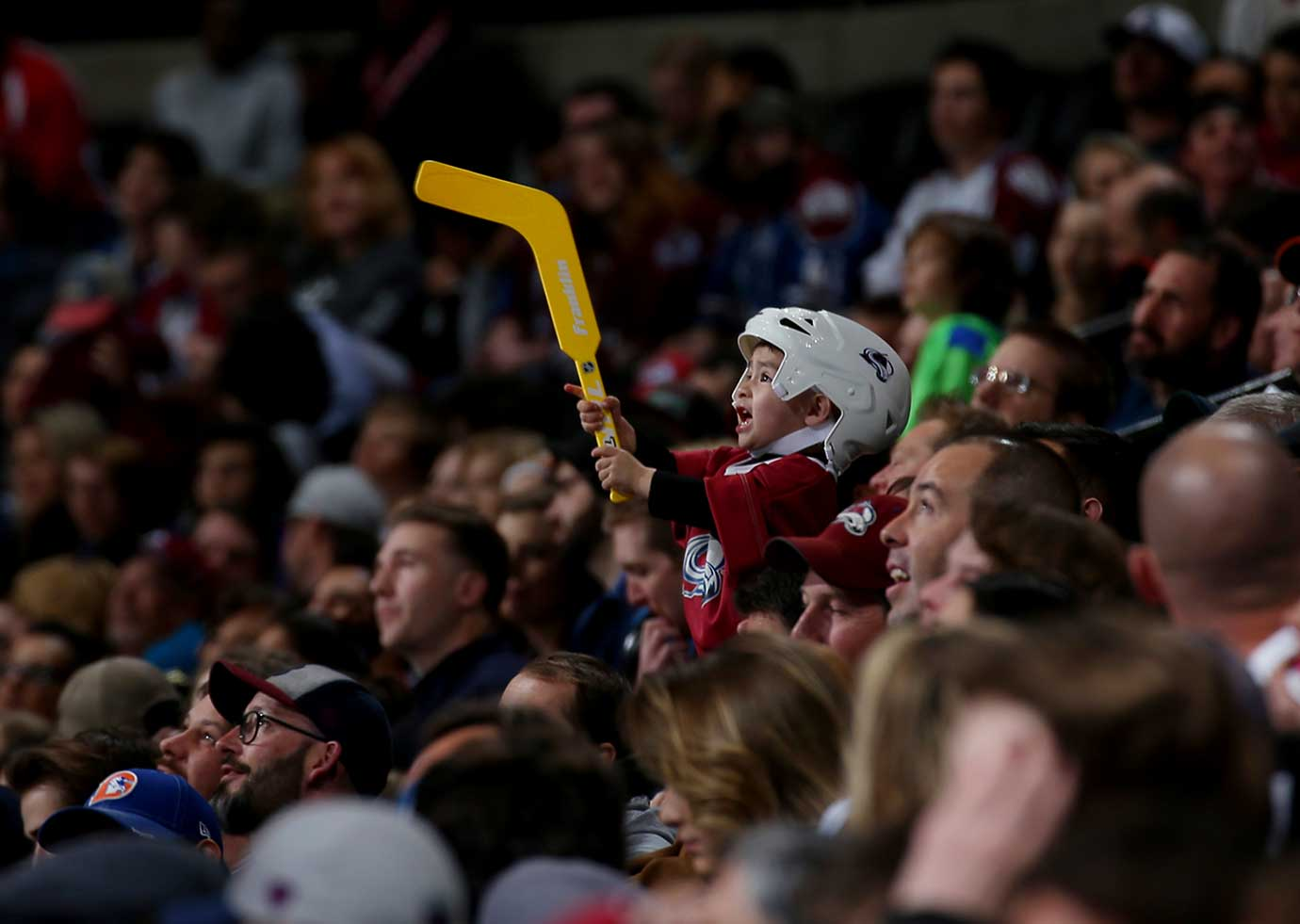 A young fan of the Colorado Avalanche cheers from the stands during the game against Florida.