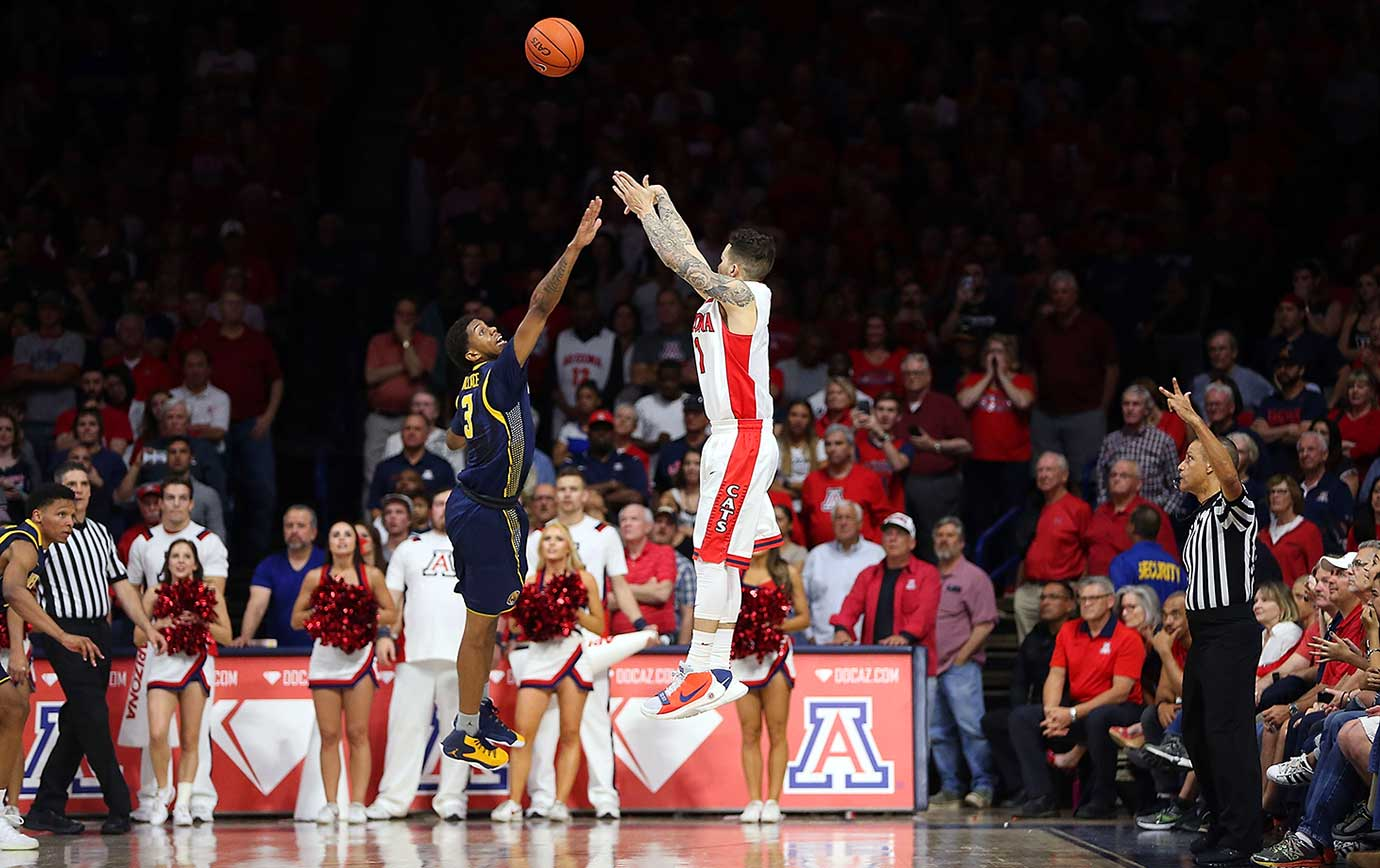 Gabe York of the Arizona Wildcats shoots the game-winning three pointer over Tyrone Wallace of Cal.