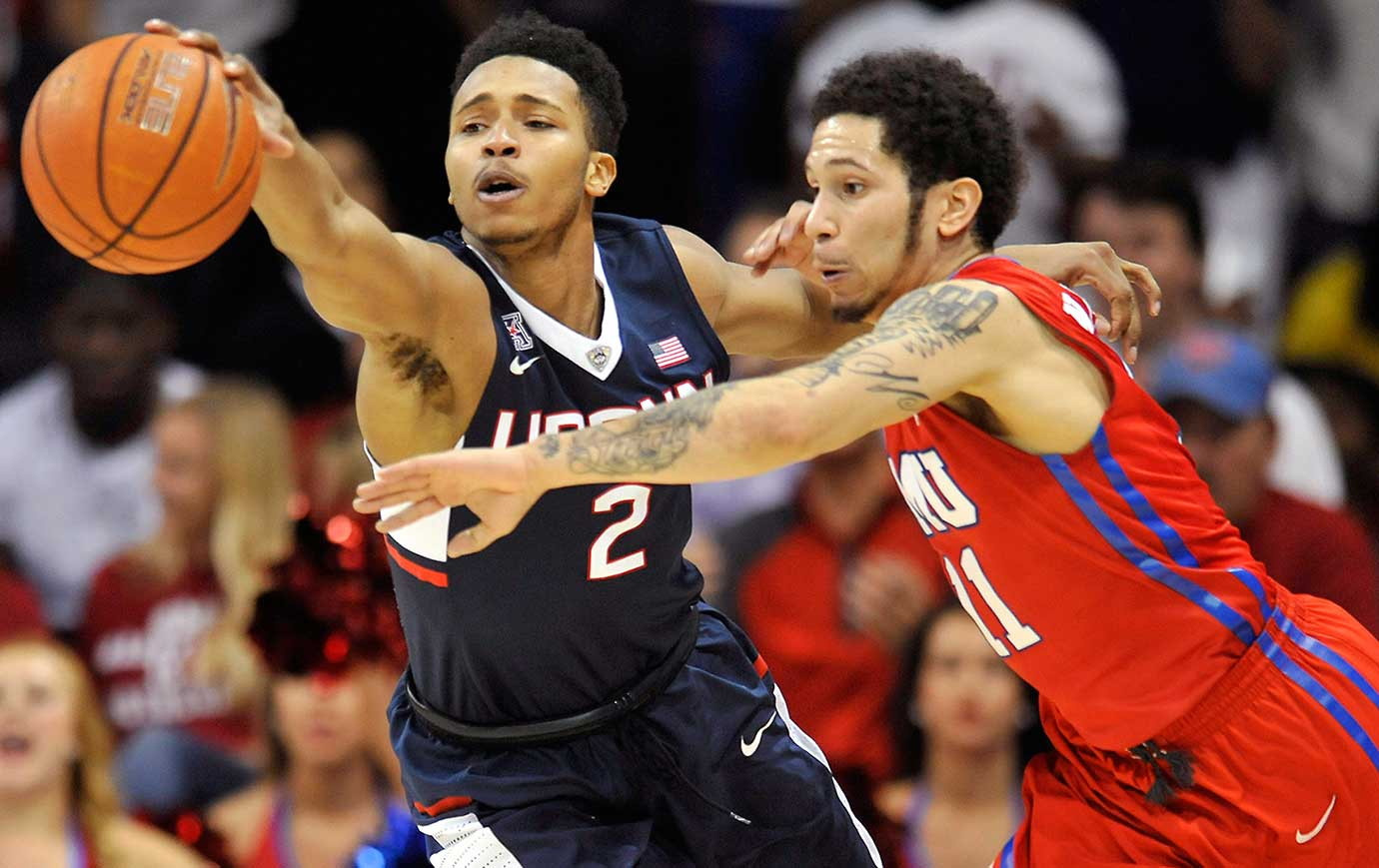 UConn's Jalen Adams nearly steals the ball from SMU's Nic Moore at Moody Coliseum.