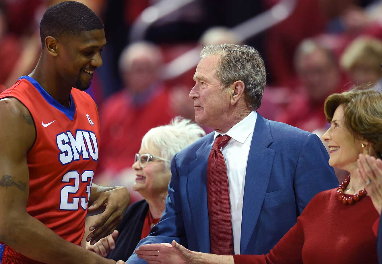 SMU's Jordan Tolbert greets former President George W. Bush and Laura Bush in Dallas.