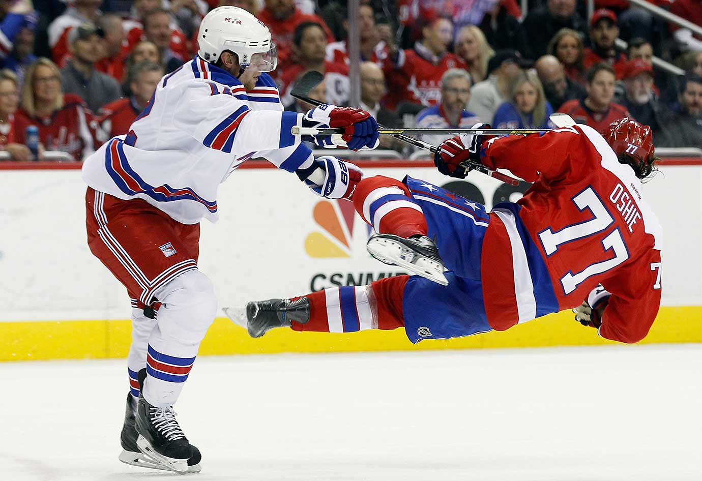 Eric Staal of the New York Rangers checks T.J. Oshie of the Washington Capitals.