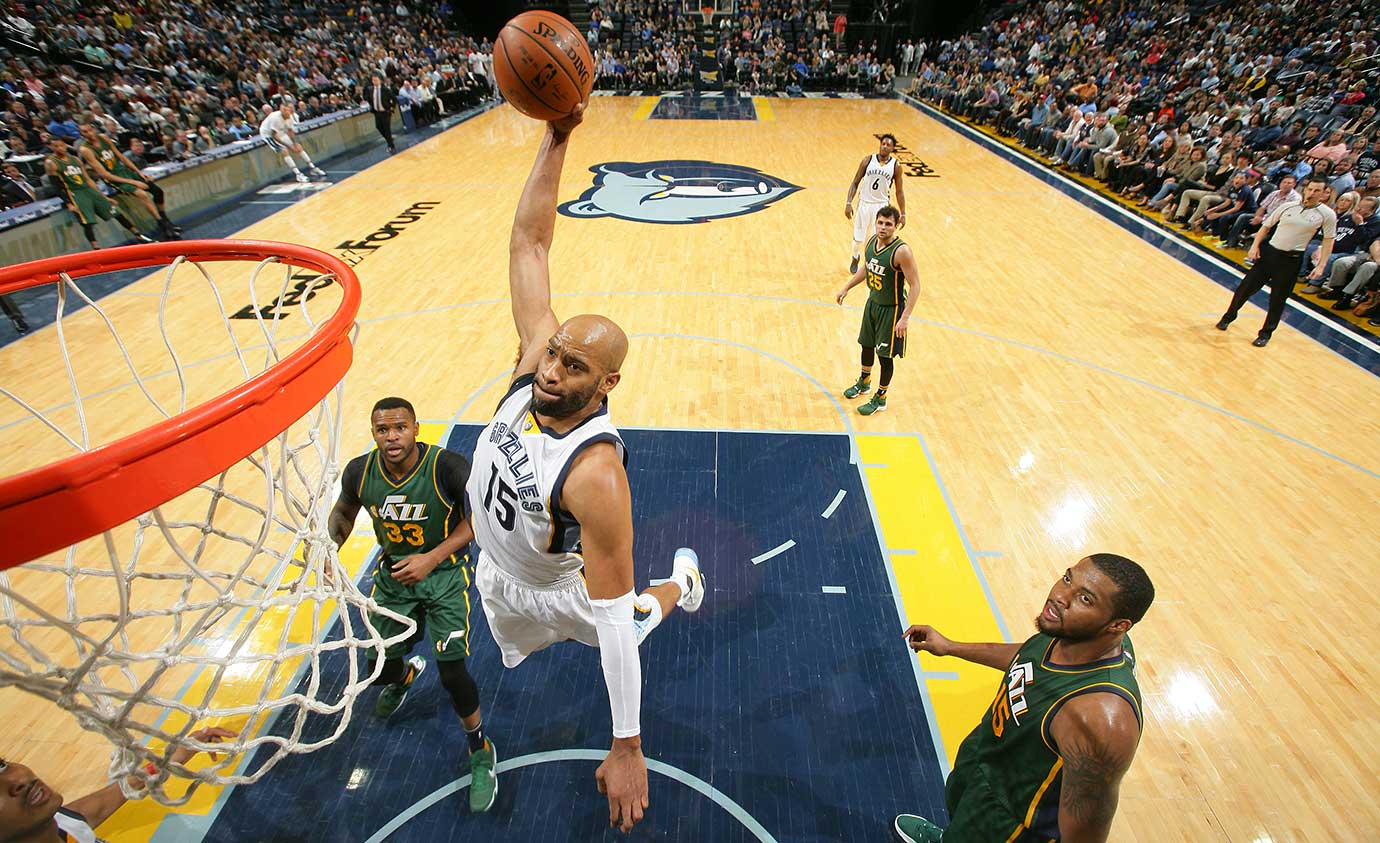 Vince Carter of the Memphis Grizzlies goes up for a dunk against the Utah Jazz.