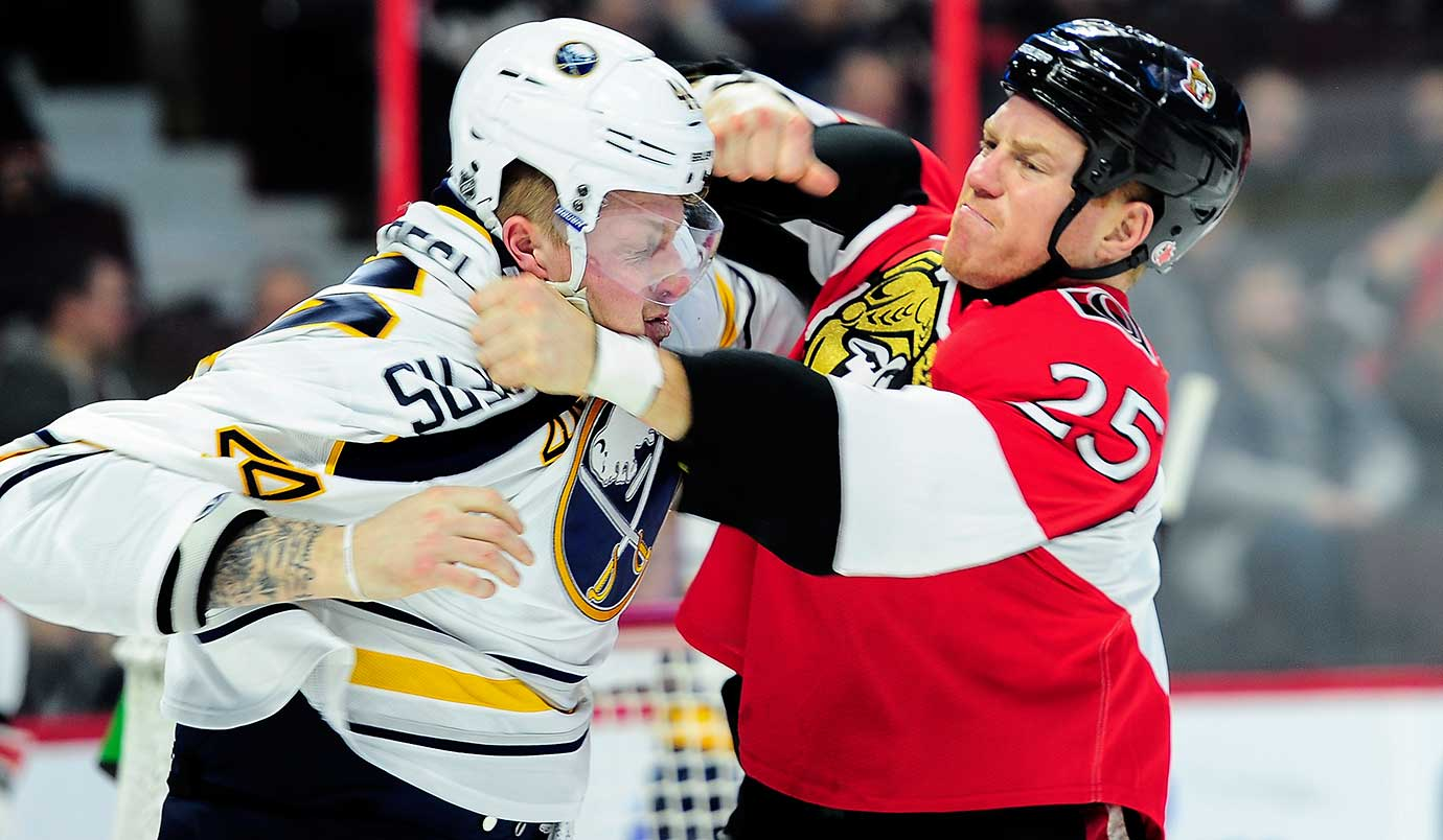Buffalo's Nicolas Deslauriers and Ottawa's Chris Neil fight during their game in Ontario, Canada.