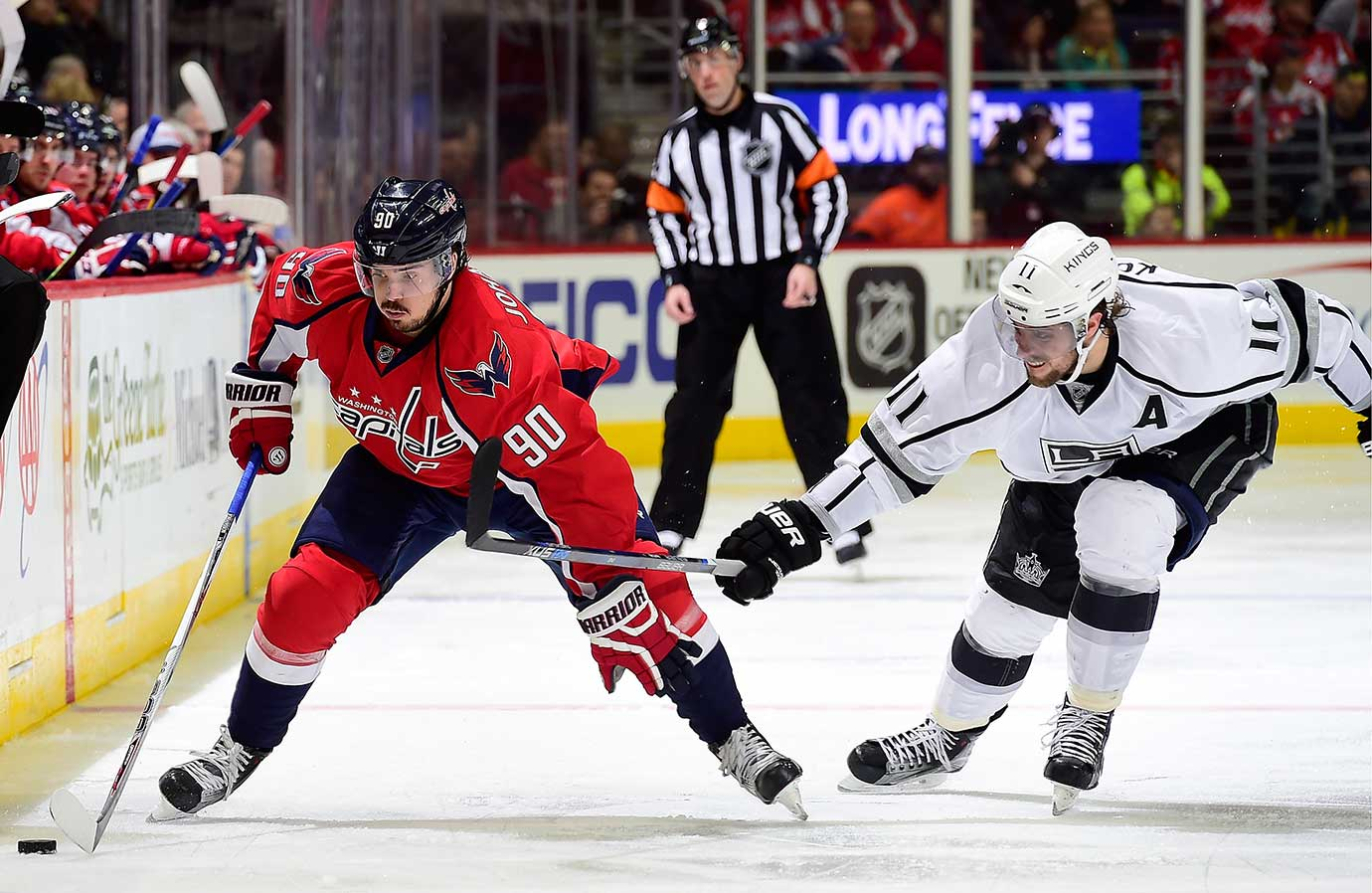 Marcus Johansson of the Washington Capitals skates with the puck against Anze Kopitar of the L.A. in a possible Stanley Cup preview.