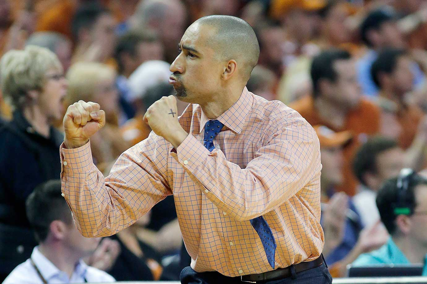 Texas head coach Shaka Smart reacts during his team's 85-78 win over West Virginia.