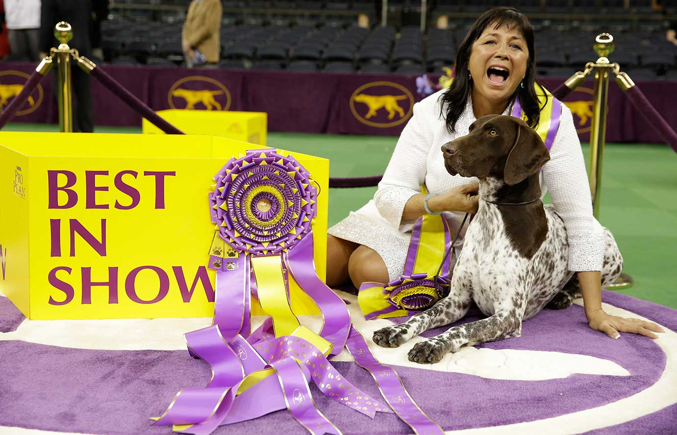 Valerie Nunes-Atkinson and C J,, a German shorthaired pointer, winning best in show at the140th Westminster Kennel Club dog show.