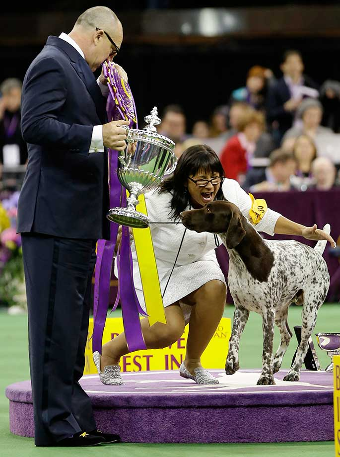 Here are some of the images that caught our eye on the sports night of Feb. 16, beginning with Valerie Nunes-Atkinson reacting after CJ, a German shorthaired pointer, won best in show at the 140th Westminster Kennel Club dog show in New York City.
