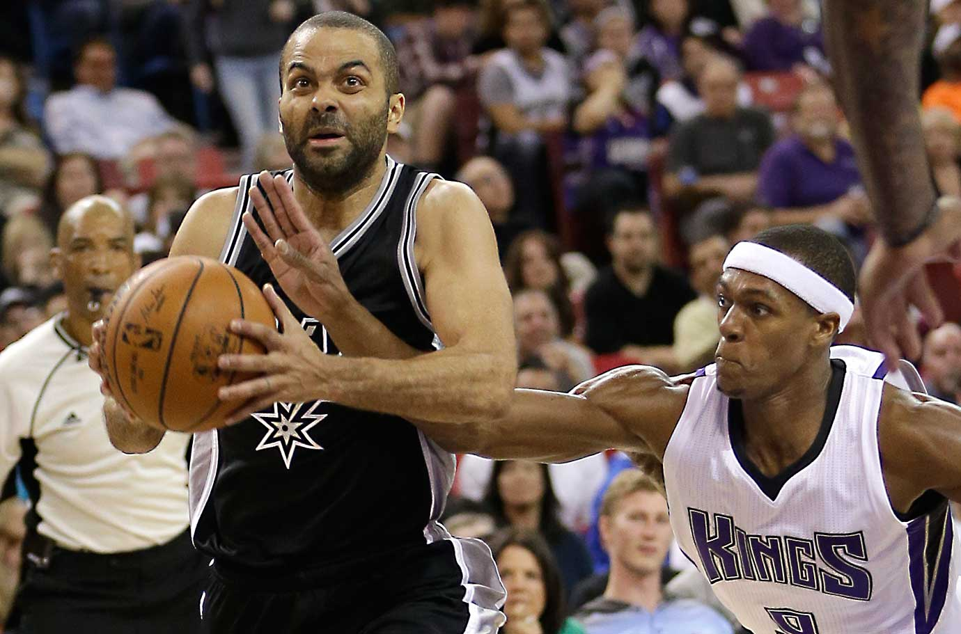 Sacramento Kings guard Rajon Rondo knocks the ball from San Antonio guard Tony Parker.