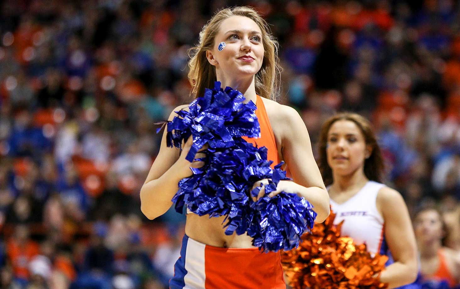 A Boise State Broncos cheerleader performs during action between the San Jose State Spartans and the Broncos at Taco Bell Arena in Boise, Idaho. Boise State won the game 94-69.