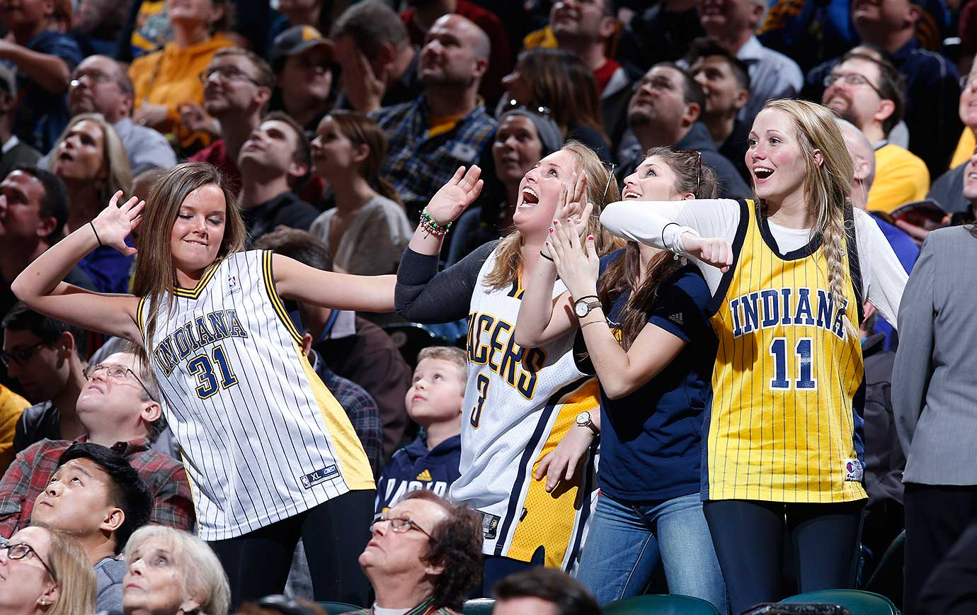 Indiana Pacers fans dance during a timeout against the Philadelphia 76ers.