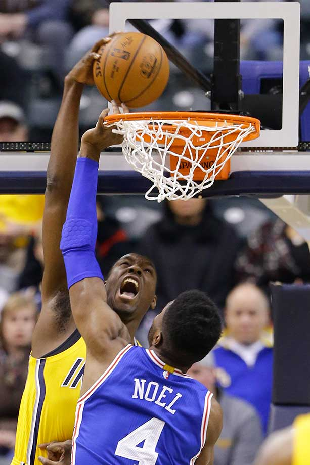 Indiana center Ian Mahinmi gets a reverse dunk over Philadelphia 76ers forward Nerlens Noel.