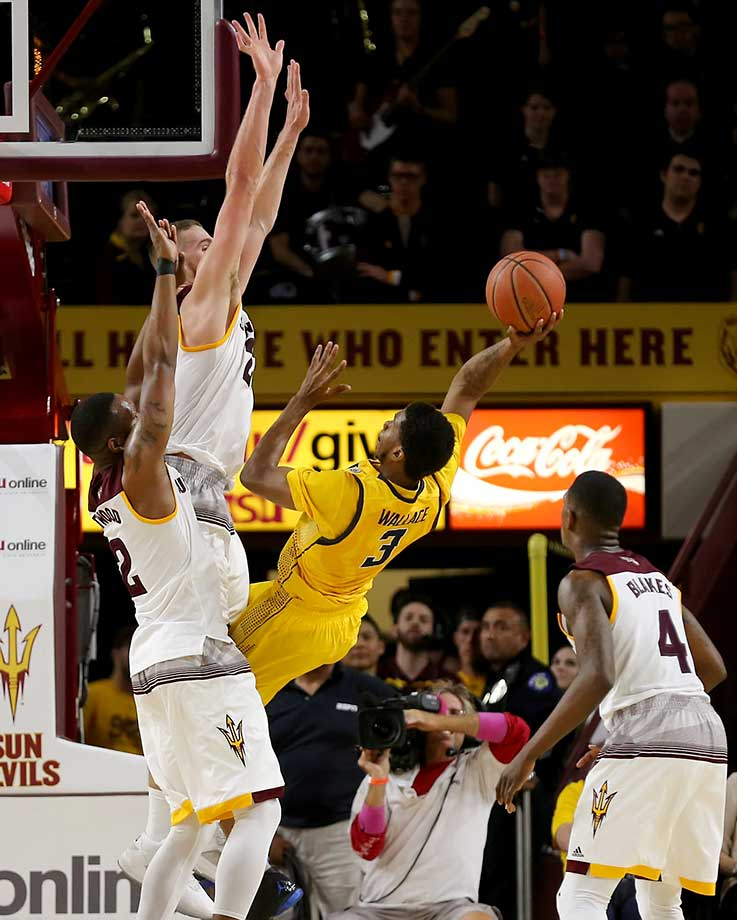 Cal's Tyrone Wallace makes an off-balance shot over Arizona State's Eric Jacobsen and Willie Atwood.