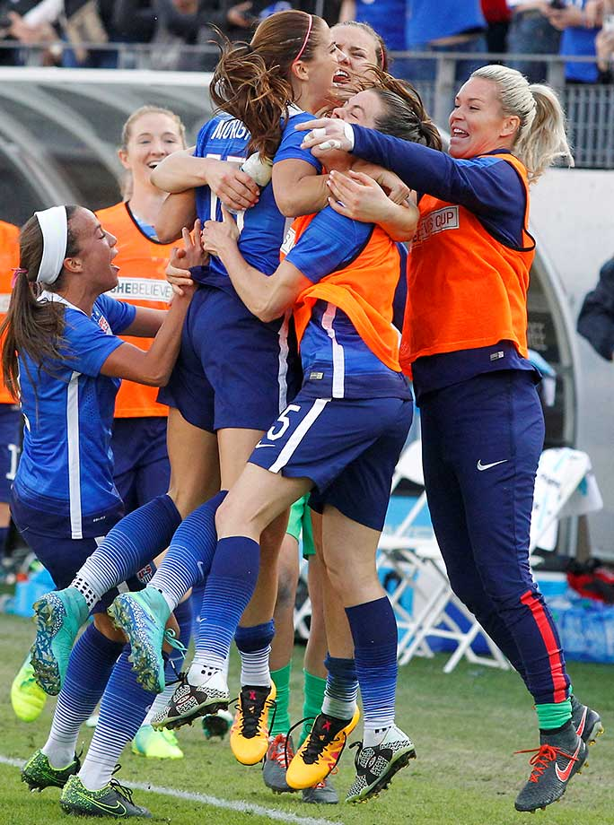 Alex Morgan celebrates with teammates after she scored the winning goal late in a 1-0 U.S. win over France in the She Believes Cup.