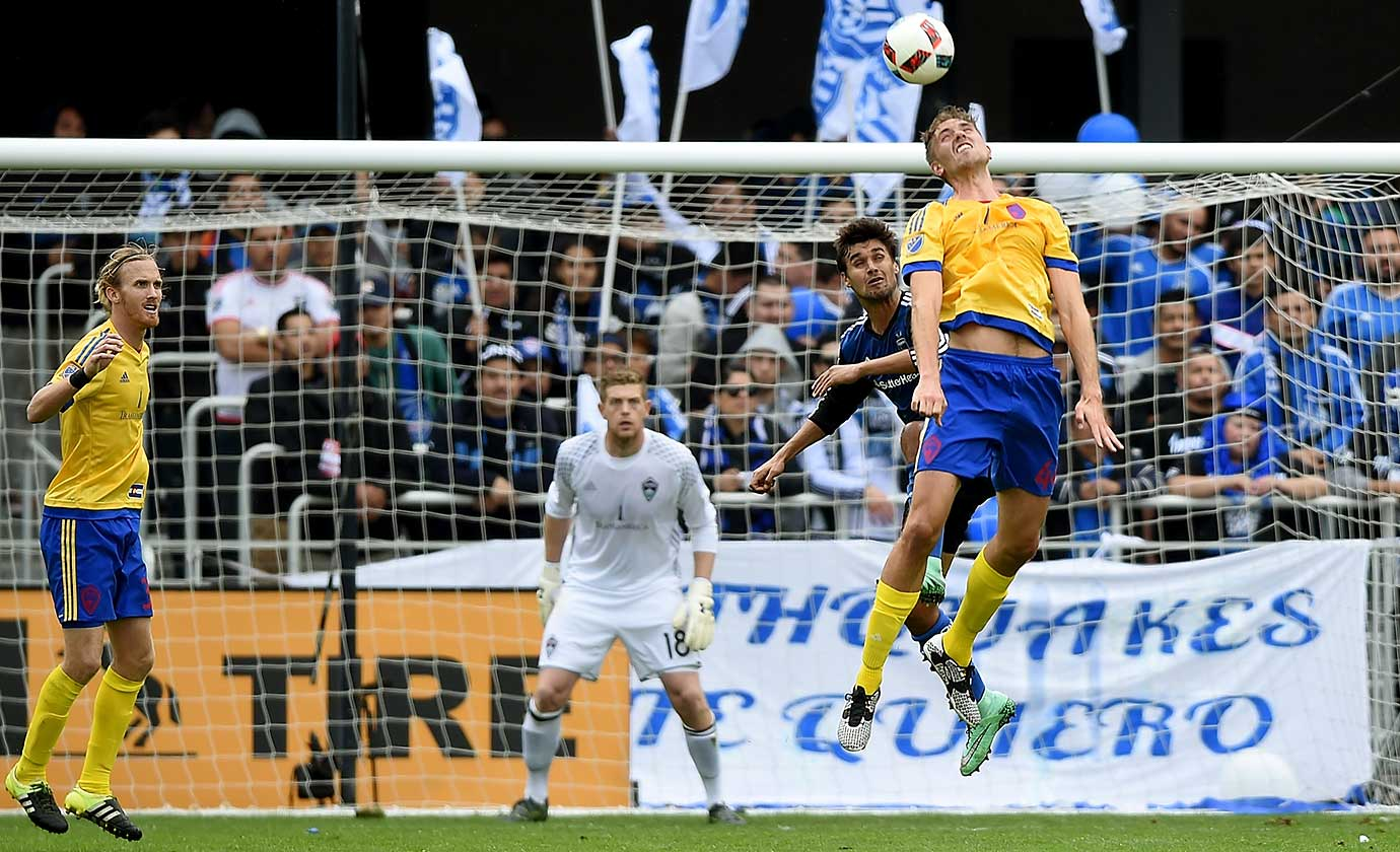Axel Sjoberg of the Colorado Rapids hits a header in front of Chris Wondolowski of the San Jose Earthquakes.