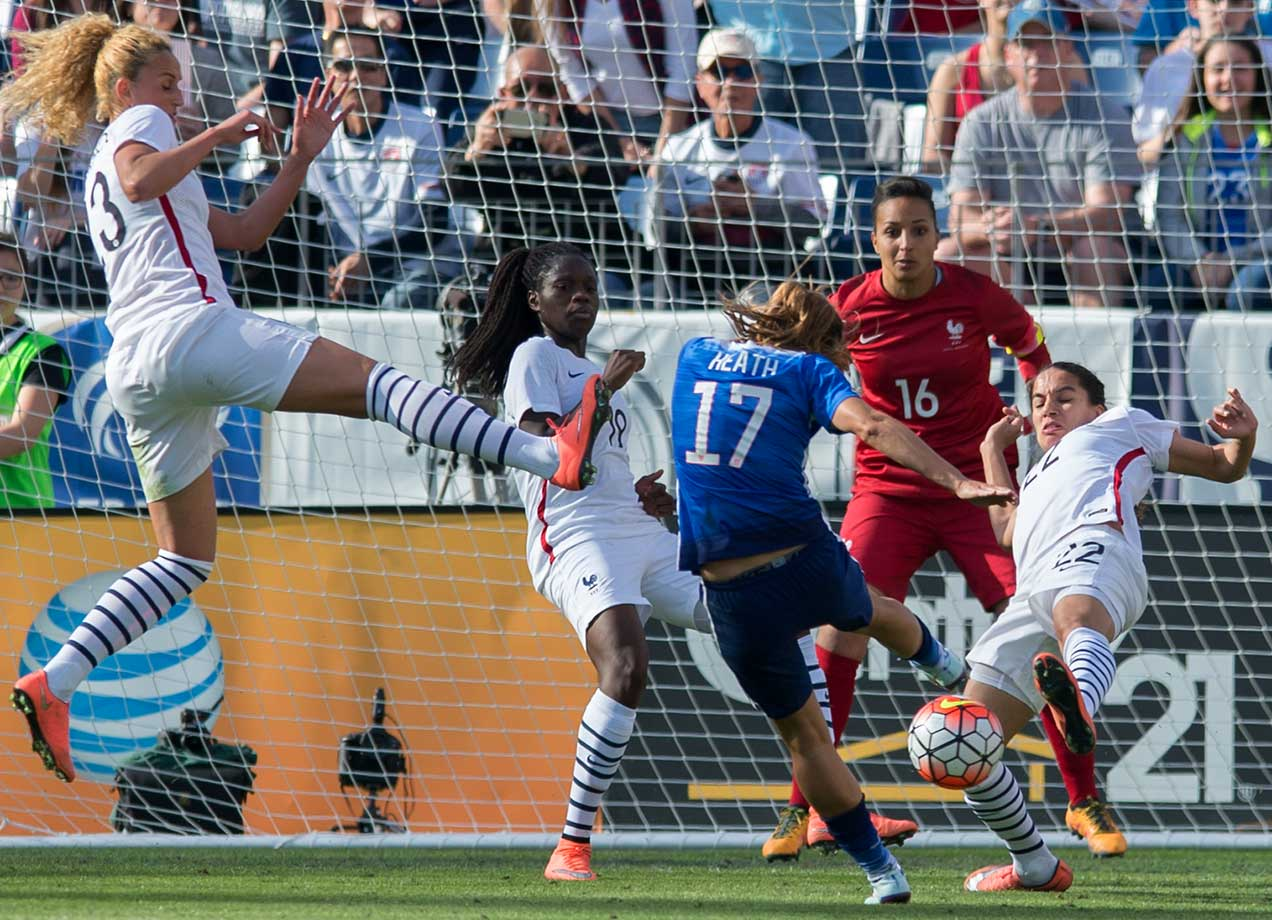 Tobin Heath of the U.S. attempts a shot against Amel Majri (22) and Sarah Bouhaddi of France during the '2016 She Believes Cup' match.