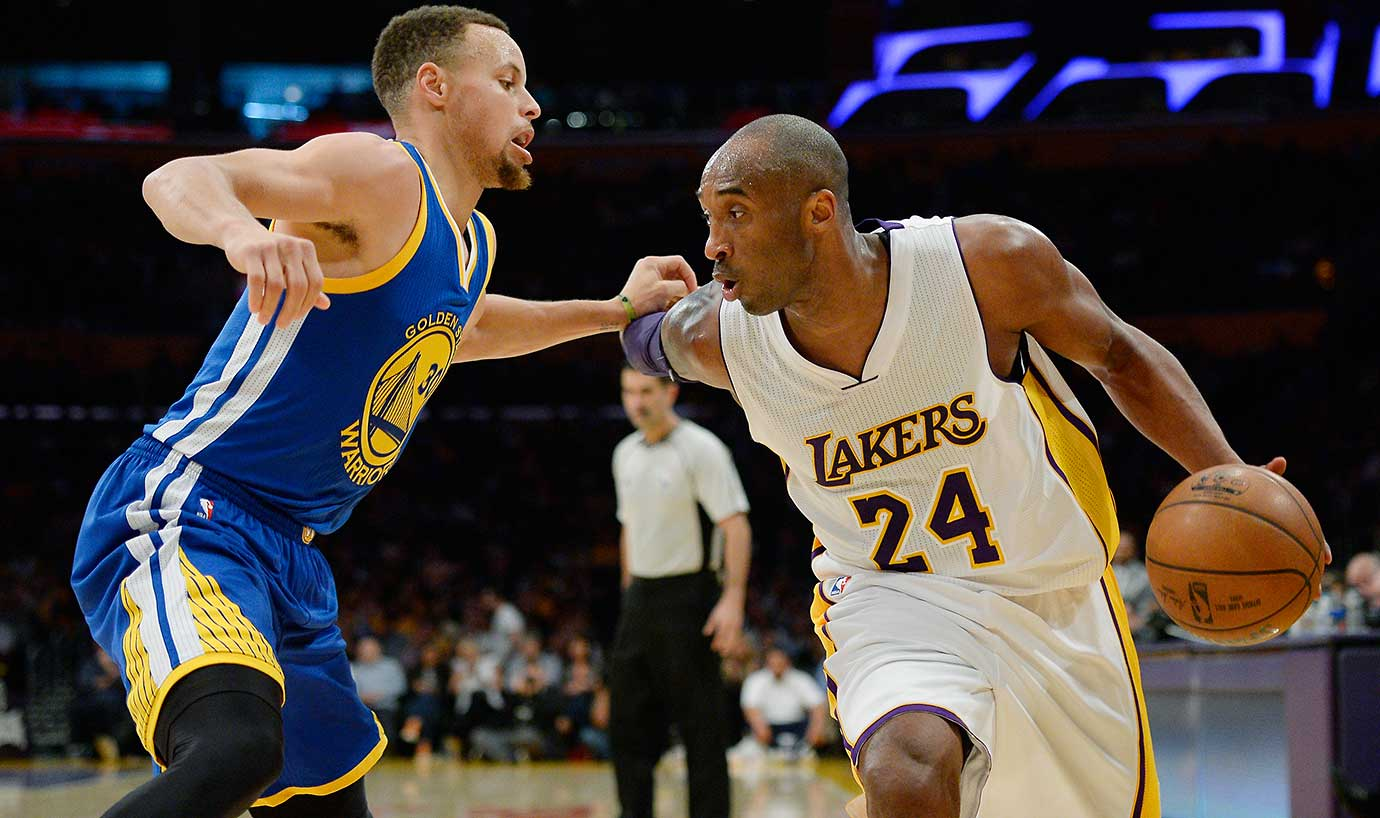 Kobe Bryant is defended by Stephen Curry during the Warriors' sixth loss of the season.