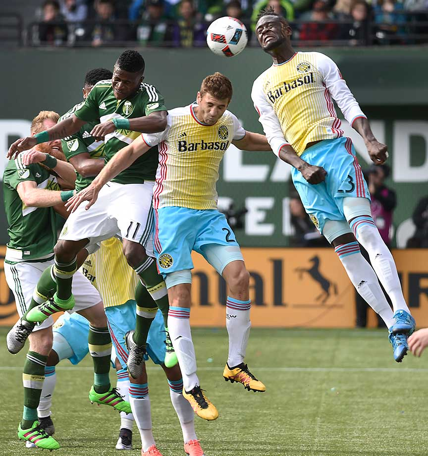 Dairon Asprilla of Portland Timbers, Gaston Sauro, 22, of Columbus Crew and Kei Kamarago go up for a ball.