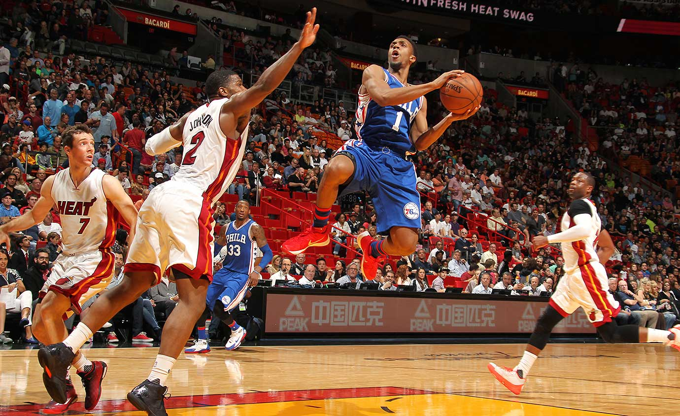 Ish Smith of the Philadelphia 76ers goes for a shot against the Miami Heat.