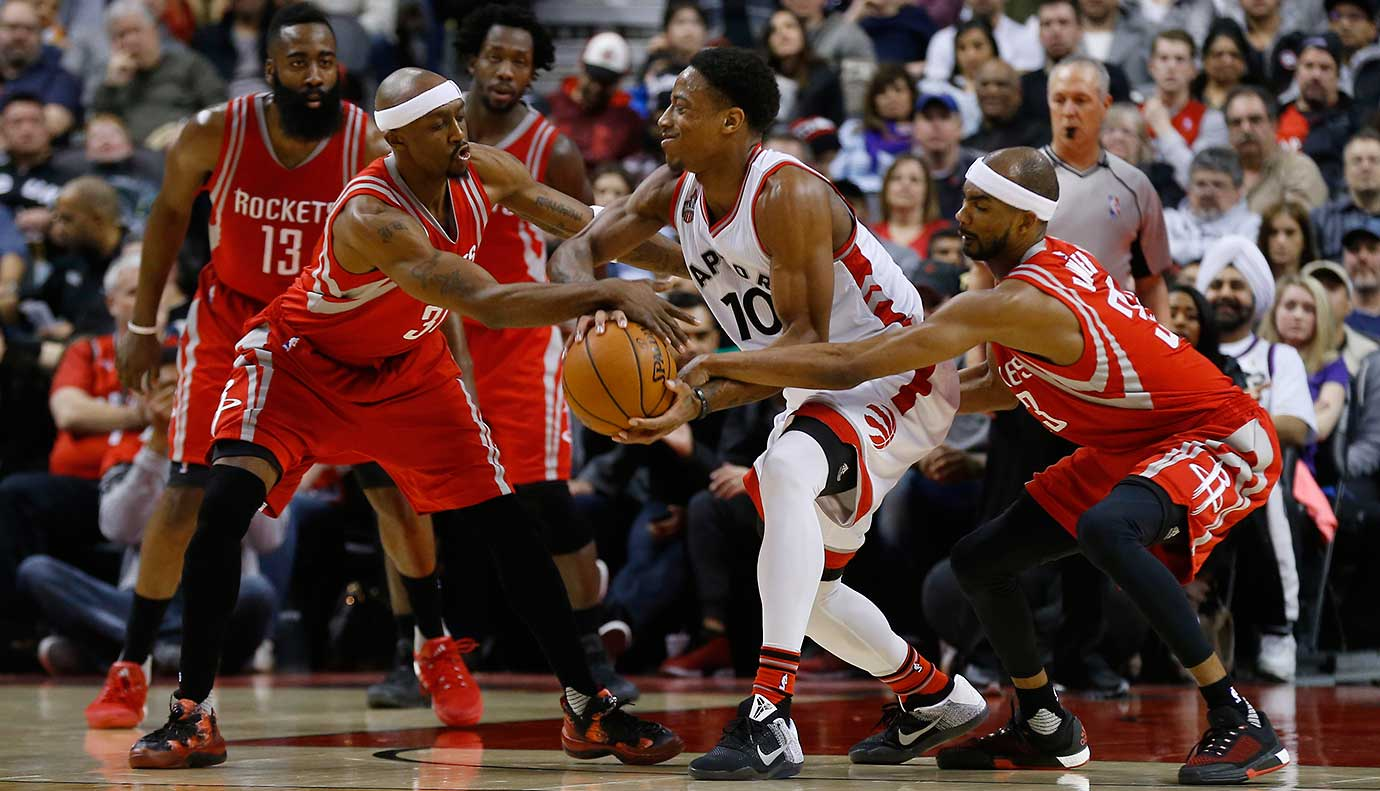 Toronto's DeMar DeRozan is swarmed by Houston's Jason Terry (31) and Corey Brewer.