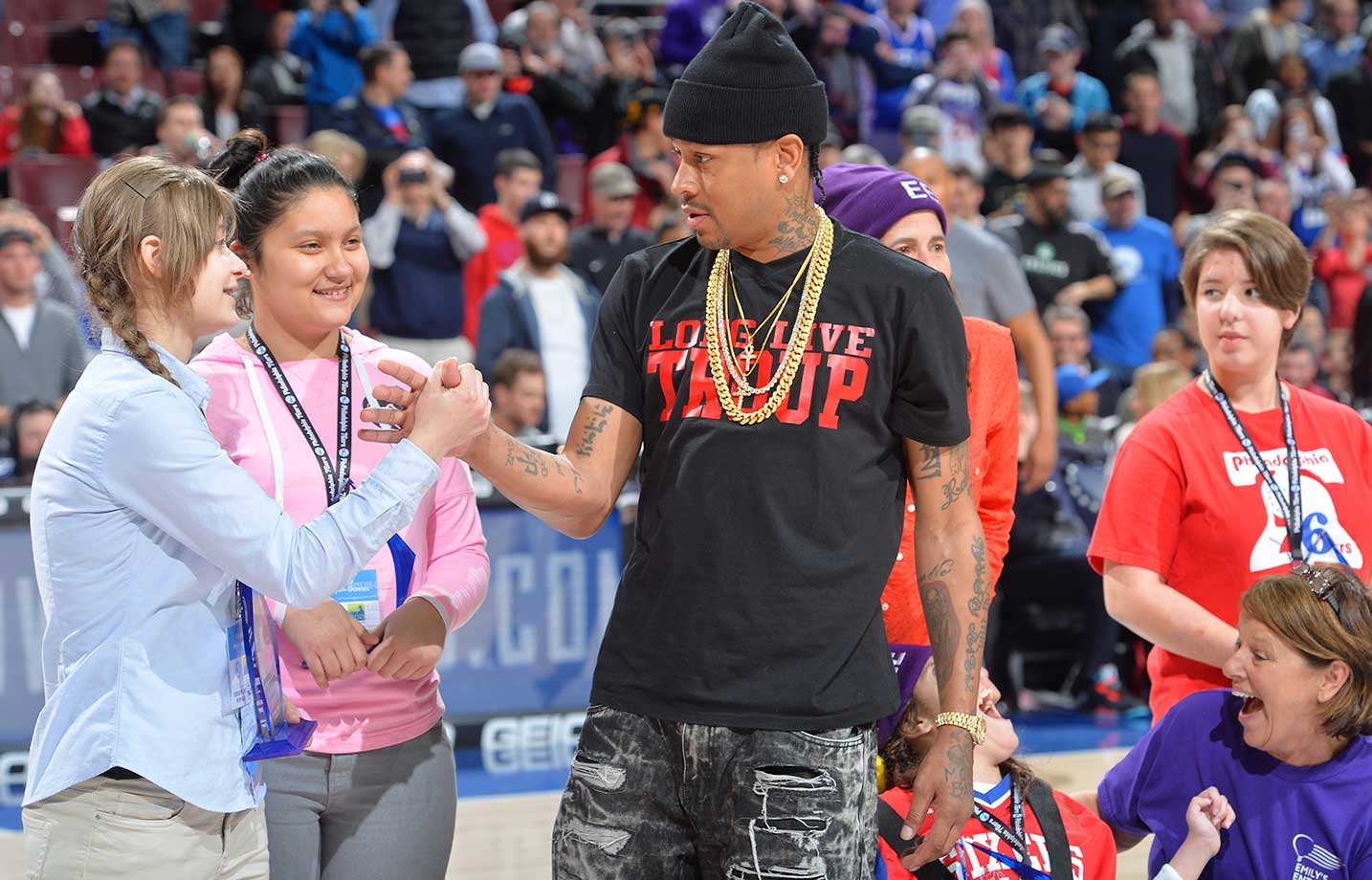 Former NBA star Allen Iverson greets fans at center court against the Sacramento Kings.