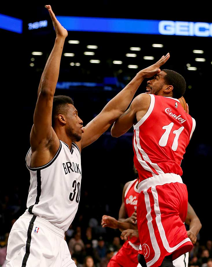 Mike Conley of the Memphis Grizzlies heads for the net as Thaddeus Young of the Brooklyn Nets defends.