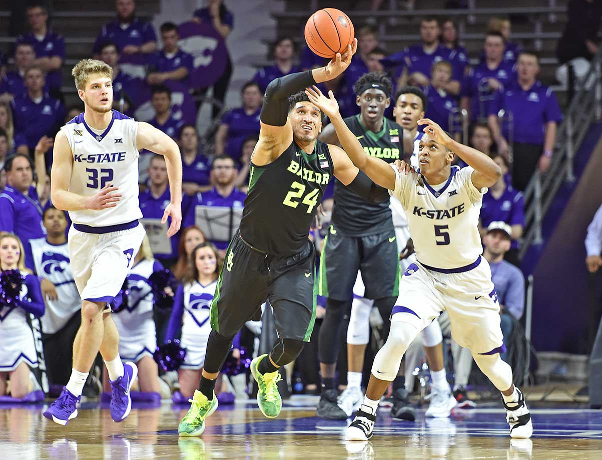 Ishmail Wainright of the Baylor Bears chases down a loose ball with guard Barry Brown of Kansas State.